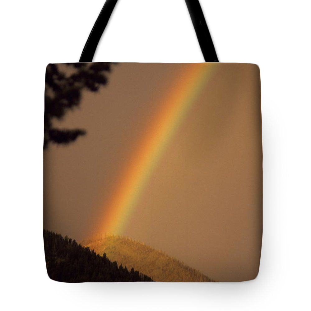 Rainbow Weather Sky Sugarloafmountain Simple Zen Colorado Rocky Mountains Tote Bag featuring the photograph Morning Rainbow by George Tuffy