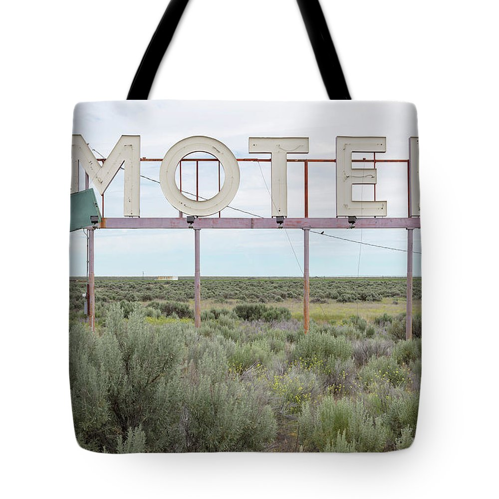 Grass Tote Bag featuring the photograph Motel Sign In Field Of Sage Brush, Out by Mint Images