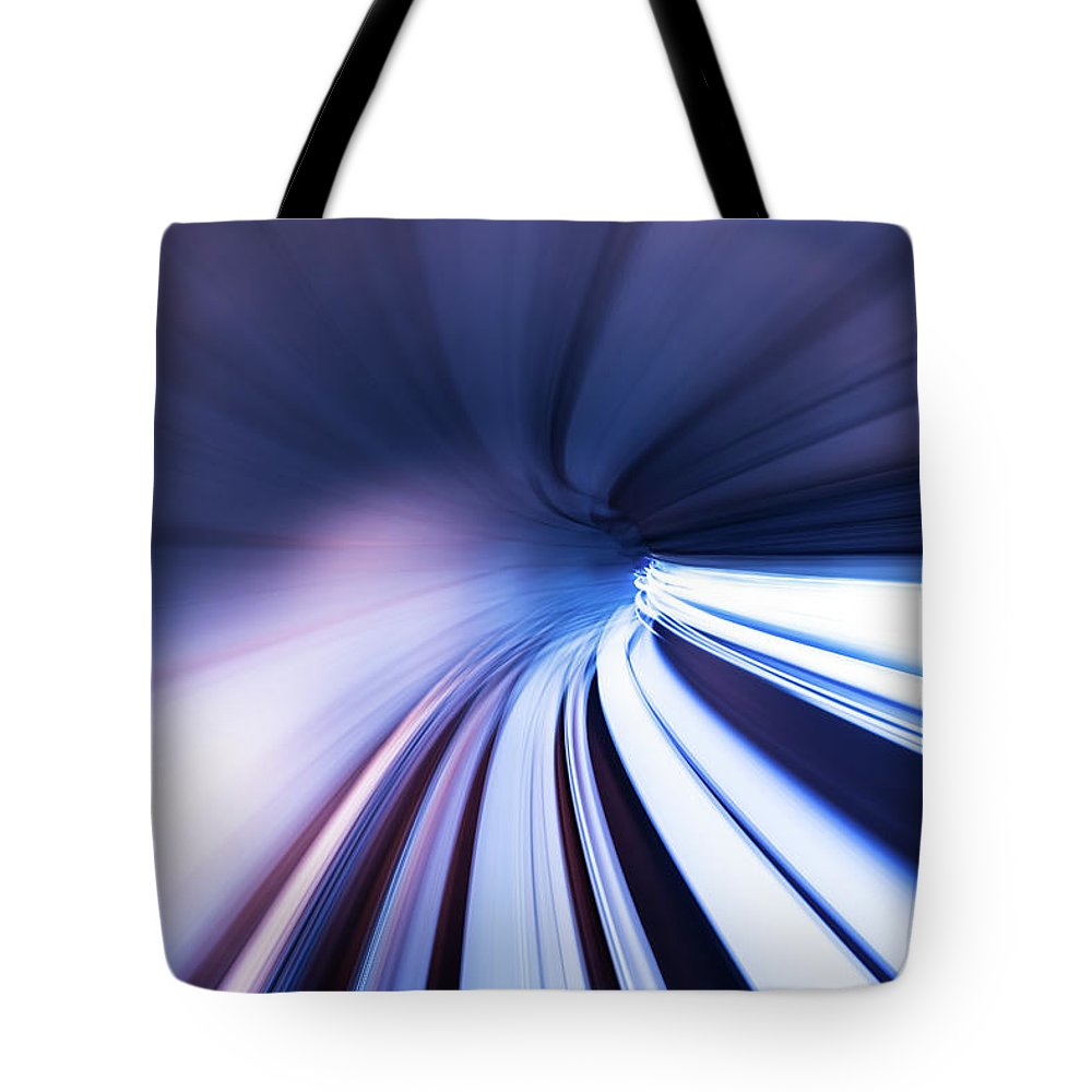 Curve Tote Bag featuring the photograph Motion Tunnel by Loveguli