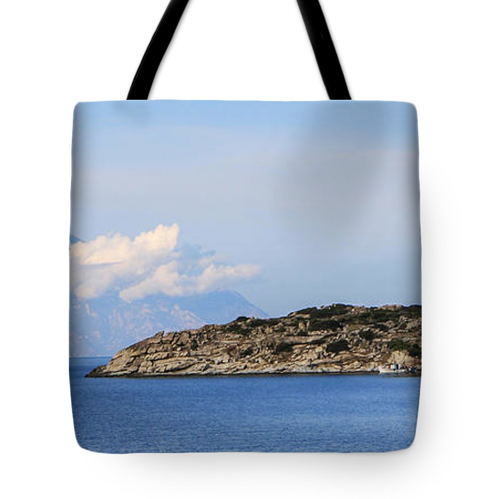 Agion Oros Tote Bag featuring the photograph Mount Athos In Clouds View From Sithonia Greece by Jivko Nakev