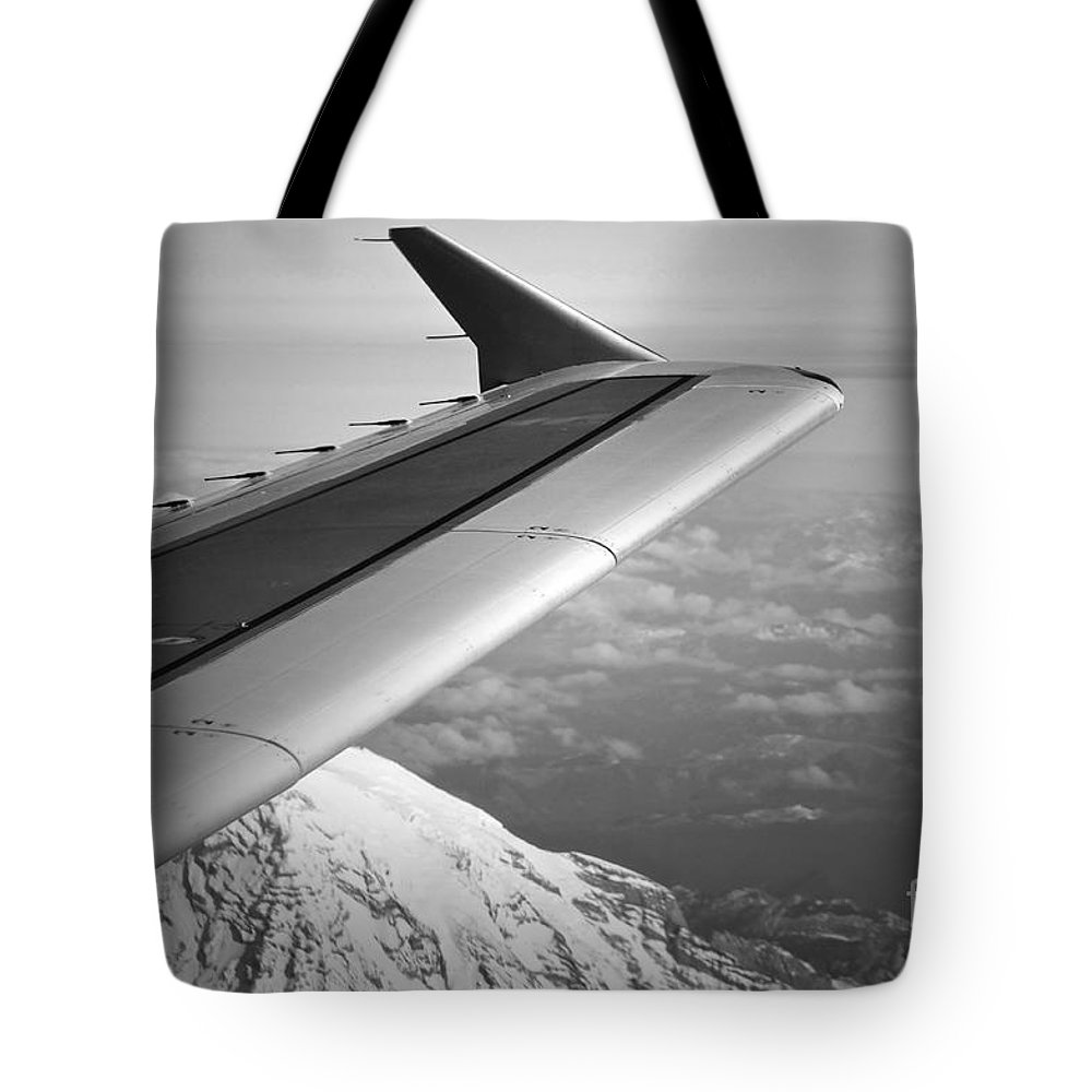 Plane Tote Bag featuring the photograph Mountain Climbing by Gwyn Newcombe