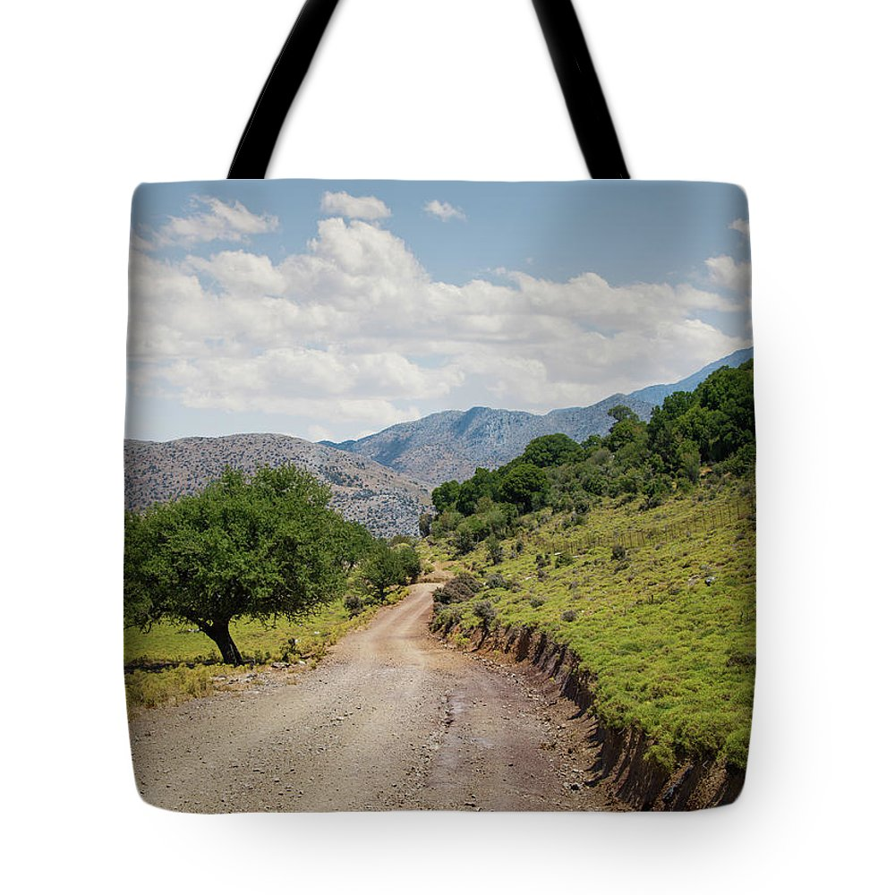 Tranquility Tote Bag featuring the photograph Mountain Dirt Road In Northern Crete by Ed Freeman