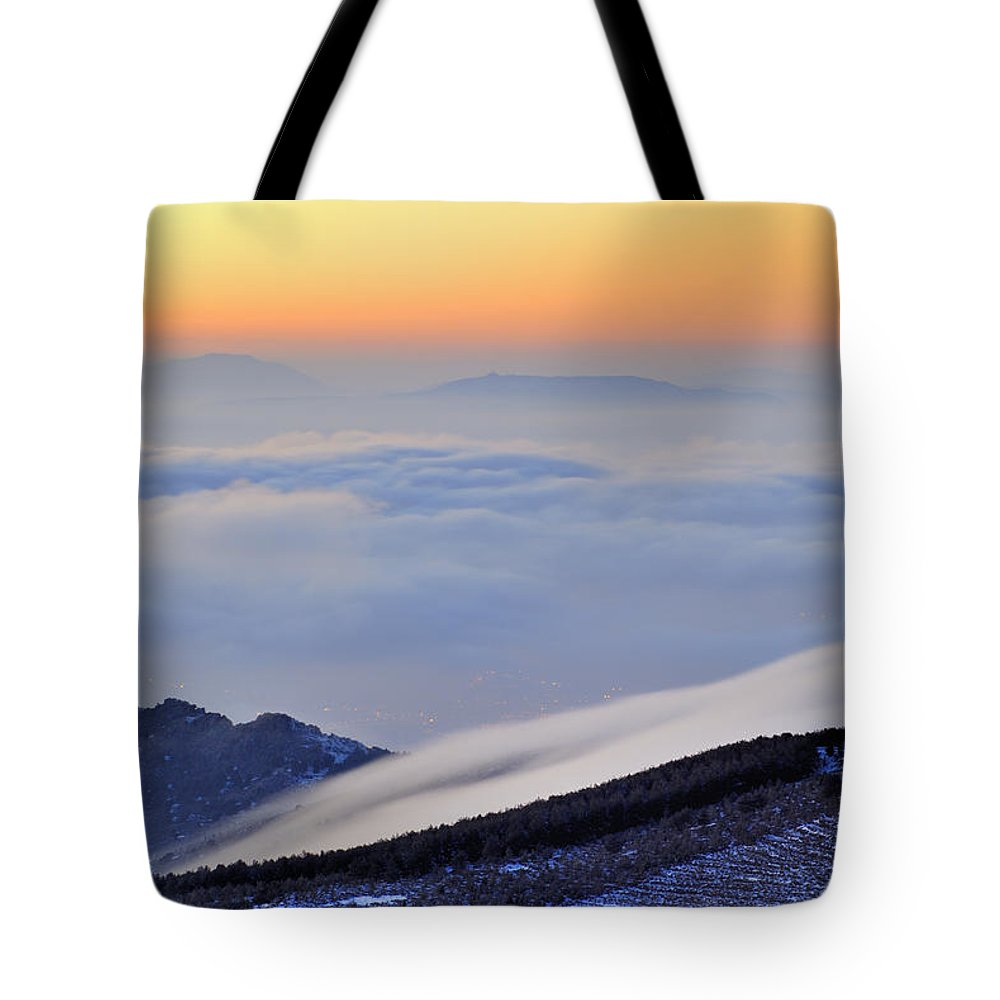 Sunset Tote Bag featuring the photograph Mountains Clouds At Sunset by Guido Montanes Castillo