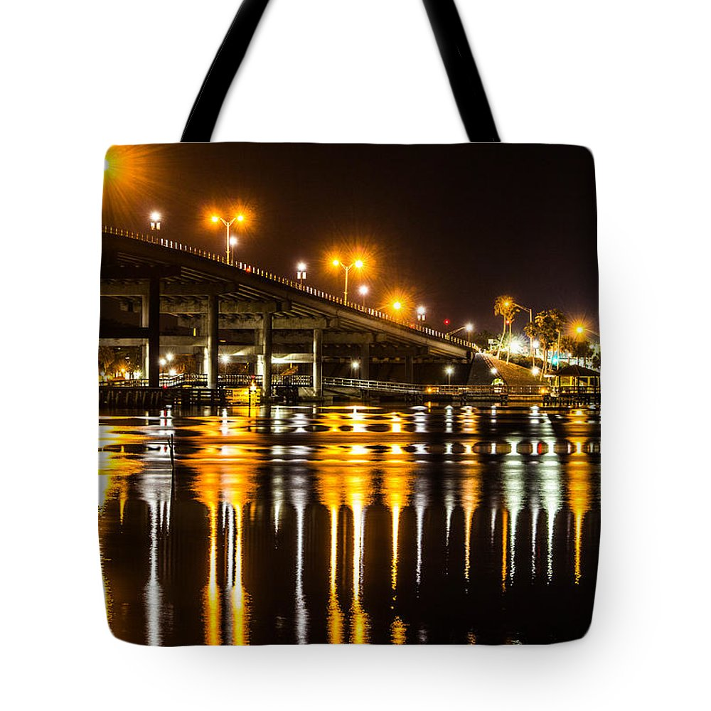 Nighttime Tote Bag featuring the photograph Moving Reflection by Tyson Kinnison