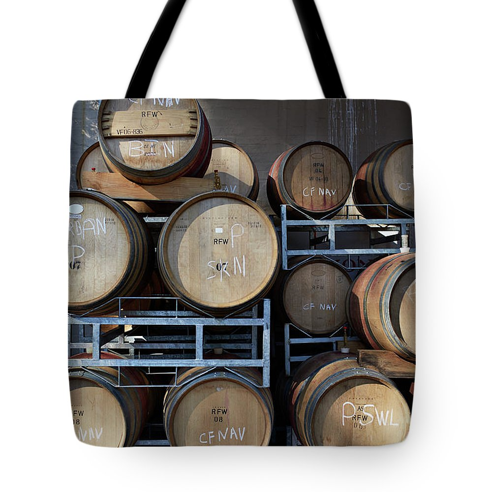 Stellenbosch Tote Bag featuring the photograph Multible Wooden French Winebarrels On by Klaus Vedfelt