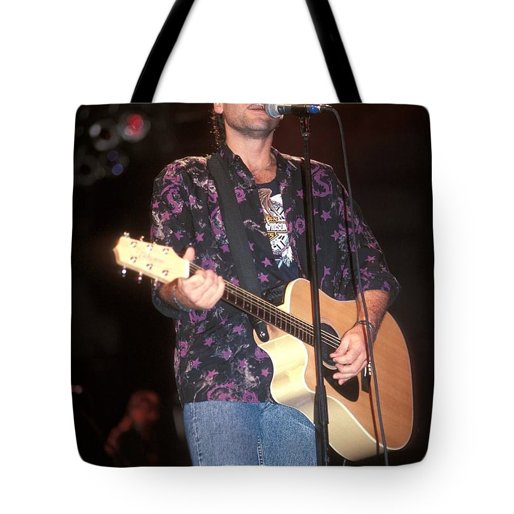 Songwriter Tote Bag featuring the photograph Musician Billy Ray Cyrus by Concert Photos