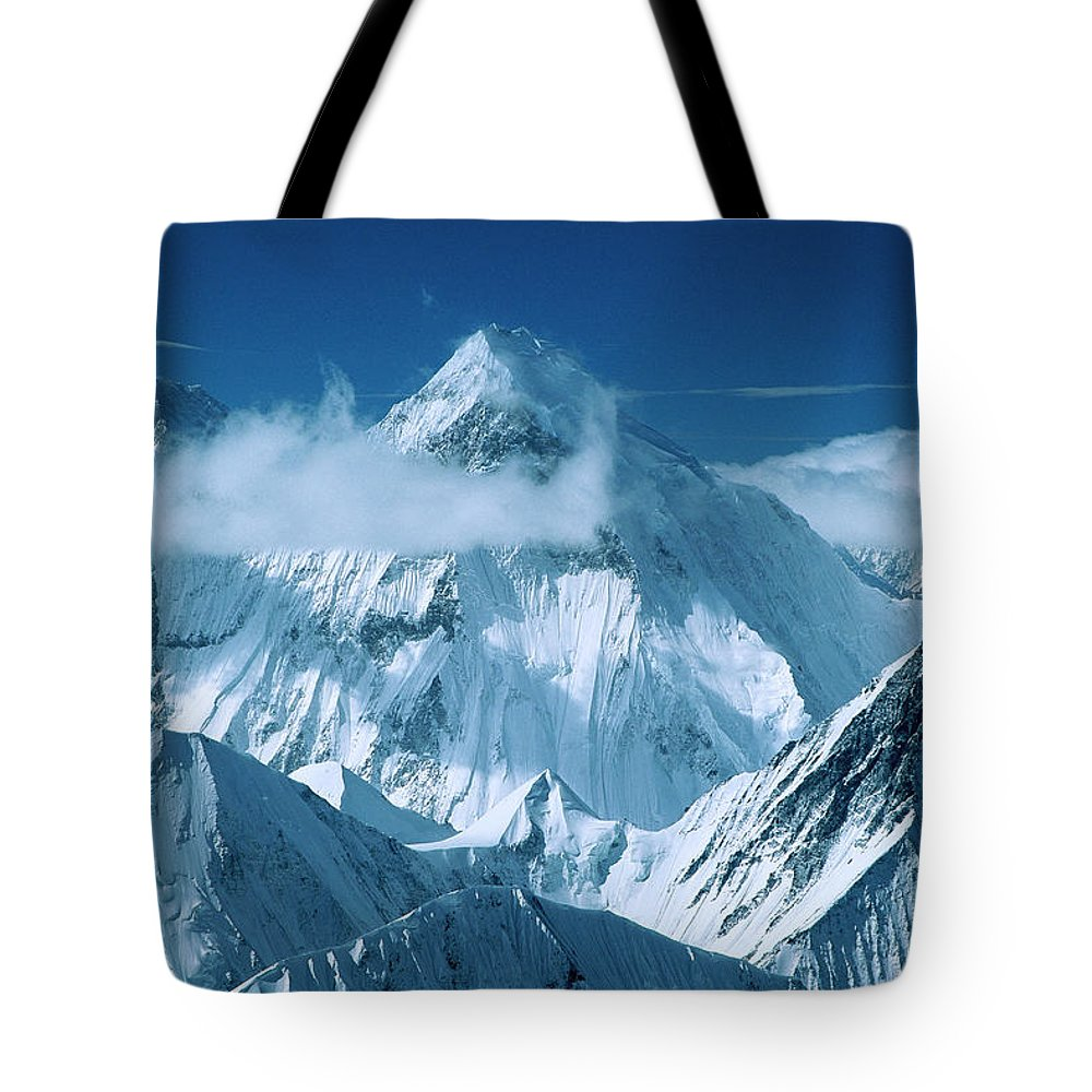 Hhh Tote Bag featuring the photograph Mustagh Tower At Center And Masherbrum by Colin Monteath