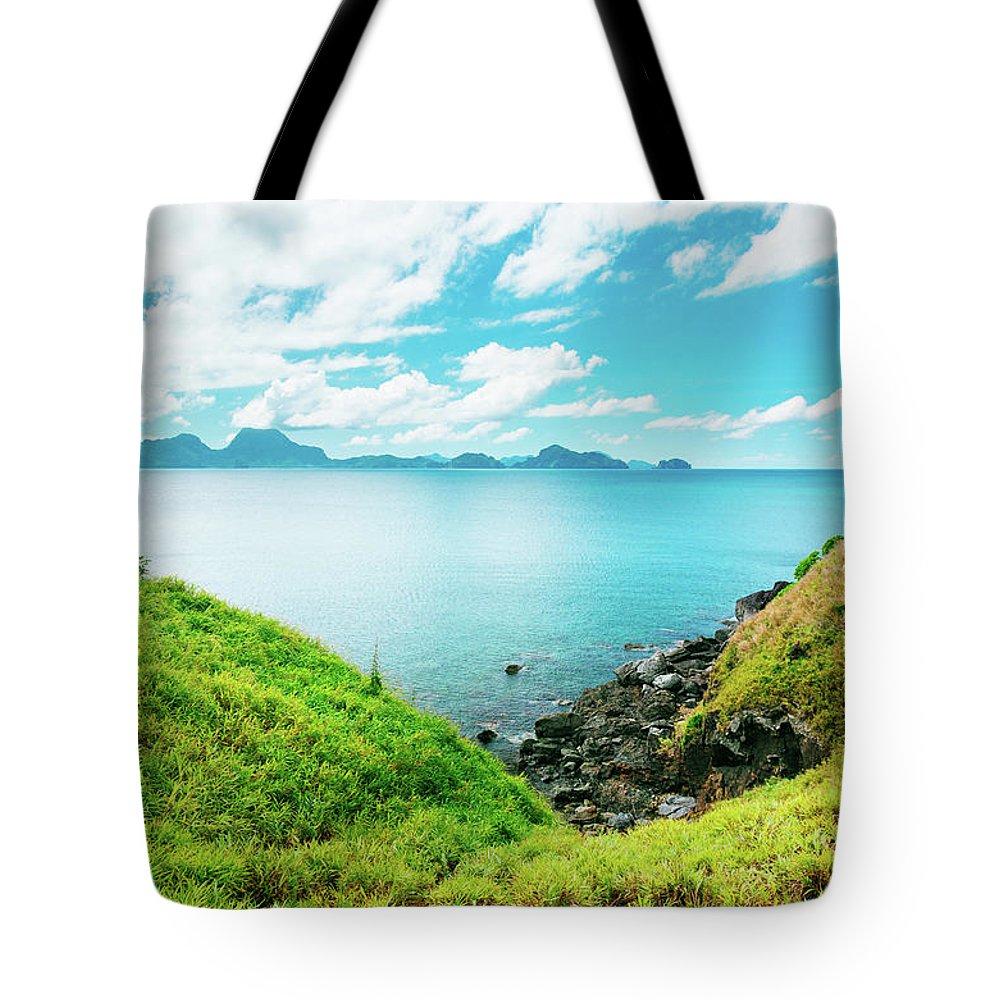 Scenics Tote Bag featuring the photograph Nacpan Beach Hills by Danilovi