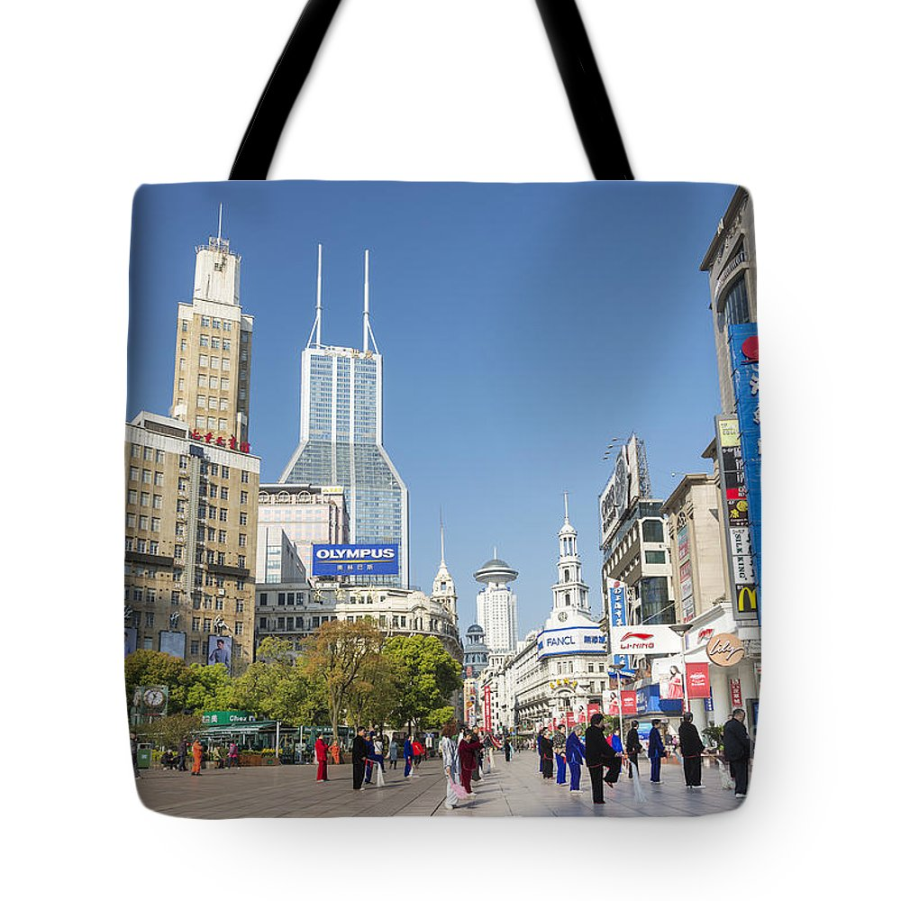 Architecture Tote Bag featuring the photograph Nanjing Road In Shanghai China by Jacek Malipan