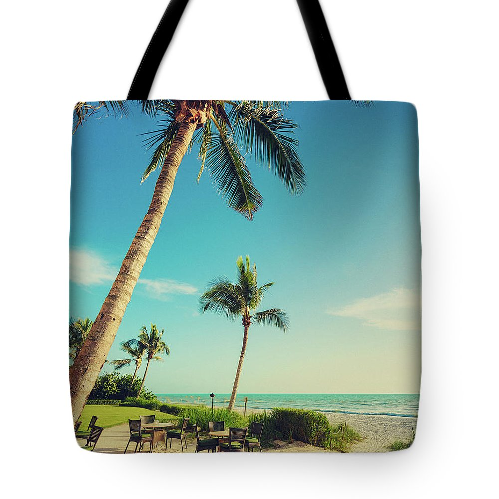 Vacations Tote Bag featuring the photograph Naple Beach Palms by Thepalmer