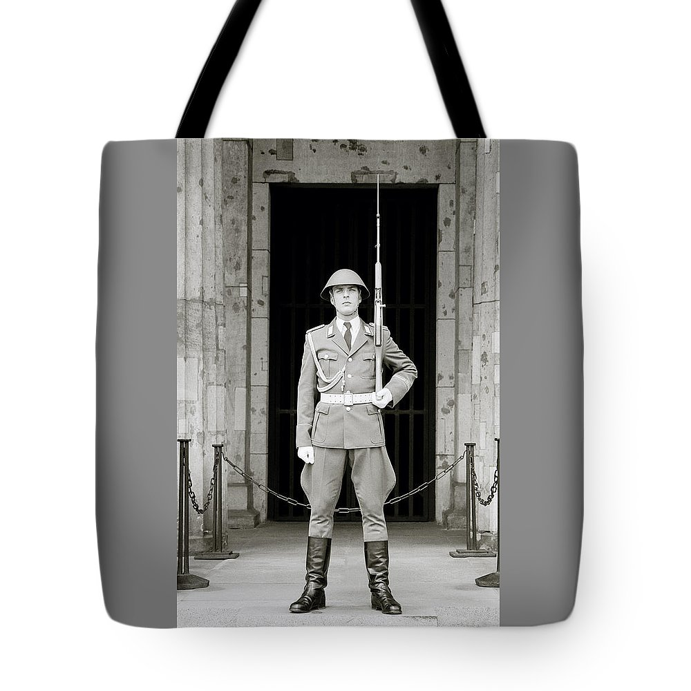 Soldier Tote Bag featuring the photograph The Soldier by Shaun Higson