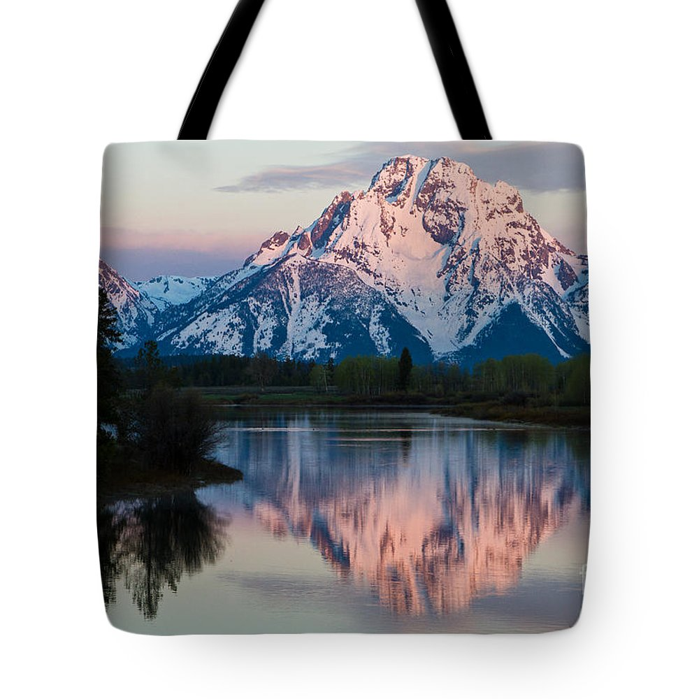 From Ox Bow Bend Tote Bag featuring the photograph New Day Of Peace In Teton National Park by Dan Hartford
