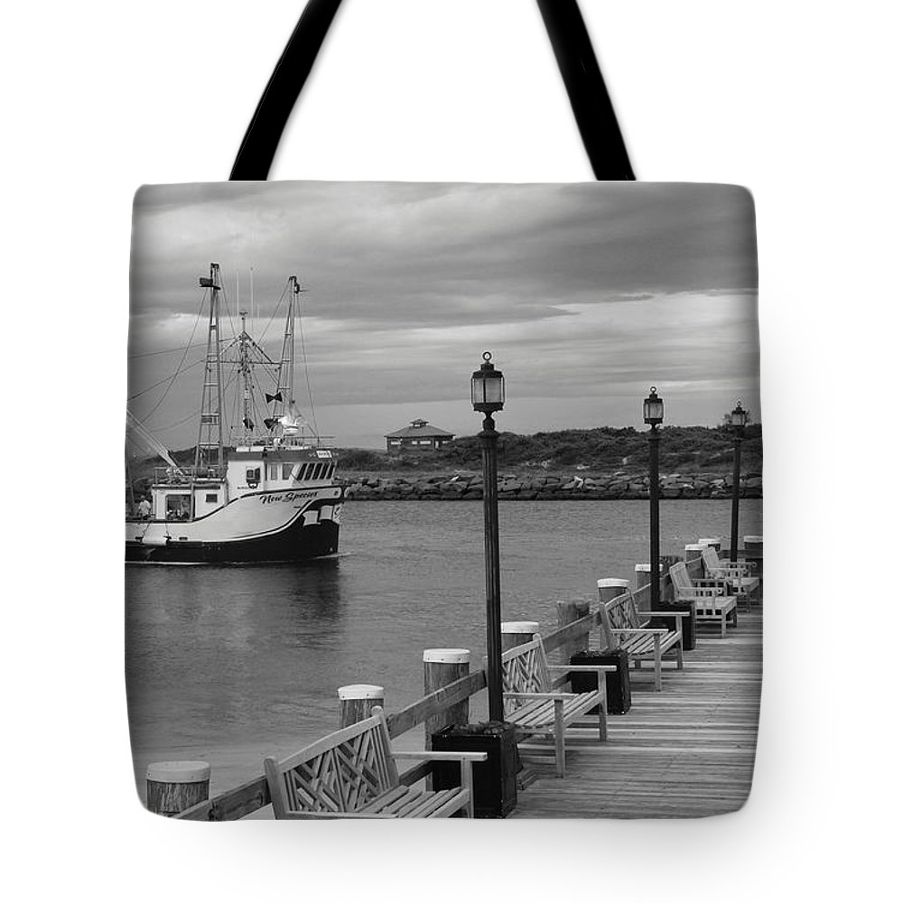 New Species Tote Bag featuring the photograph New Species Heading Home by Christiane Schulze Art And Photography