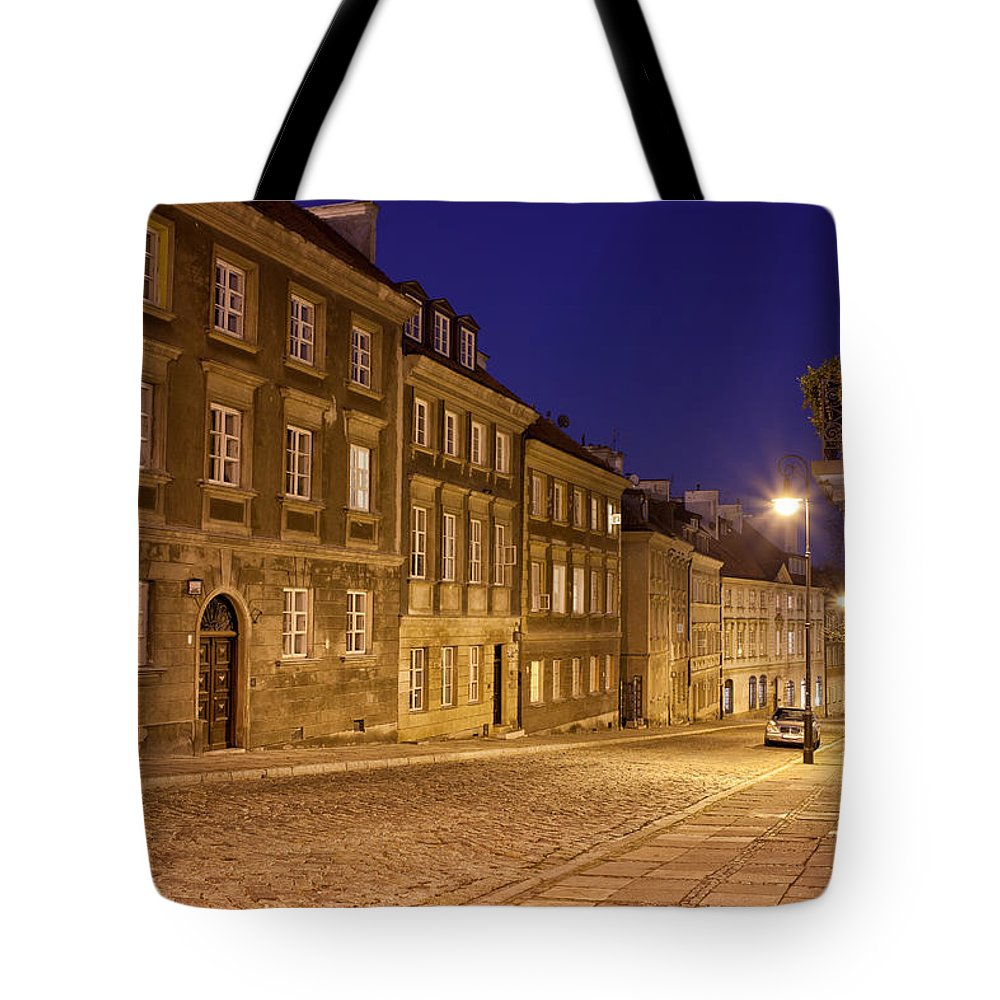 Apartment Tote Bag featuring the photograph New Town Street And Houses At Night In Warsaw by Artur Bogacki
