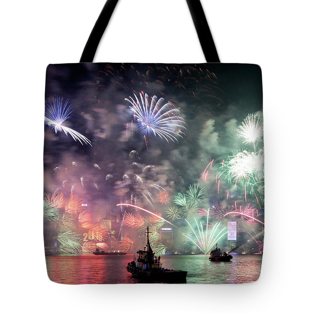 Firework Display Tote Bag featuring the photograph New Year Fireworks Hong Kong Asia by Steffen Schnur