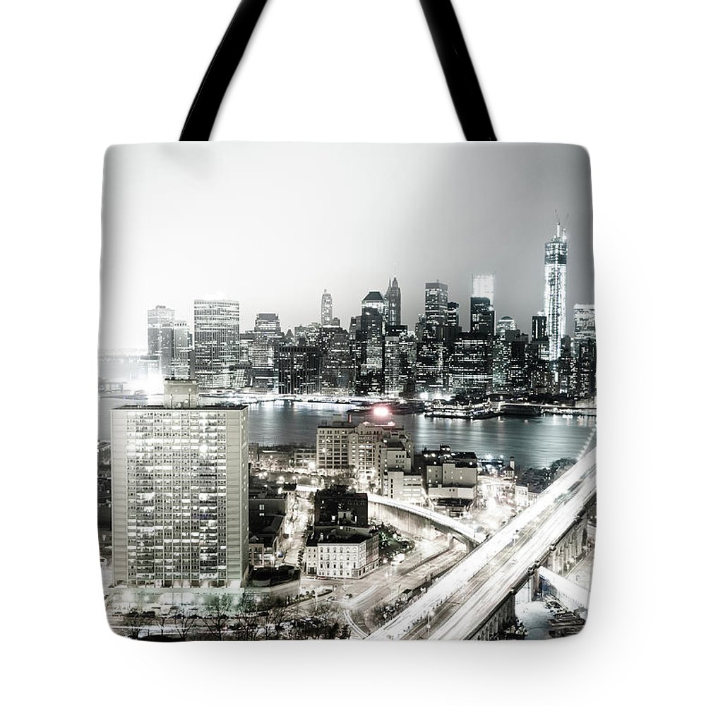 Lower Manhattan Tote Bag featuring the photograph New York City Skyline At Night by Mundusimages