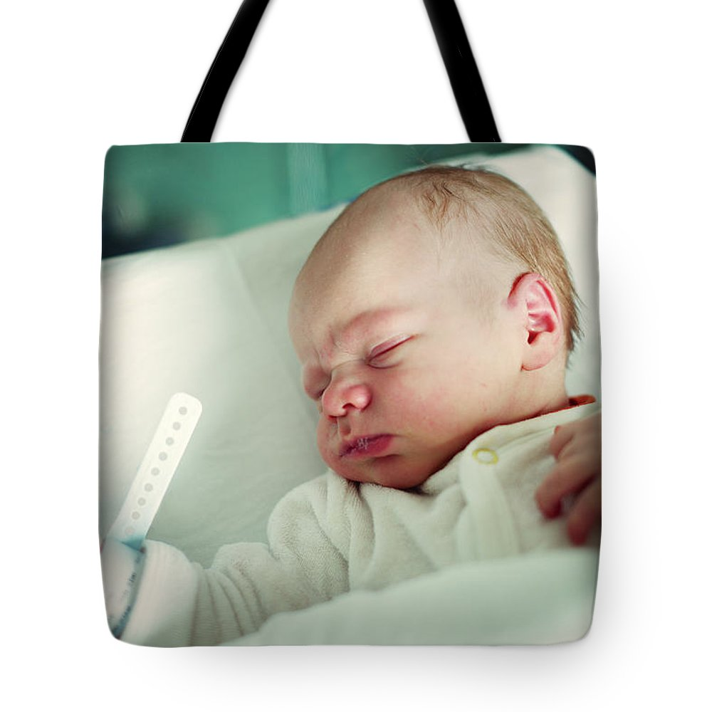 Tranquility Tote Bag featuring the photograph Newborn Boy. First Day by Aleksandr Morozov