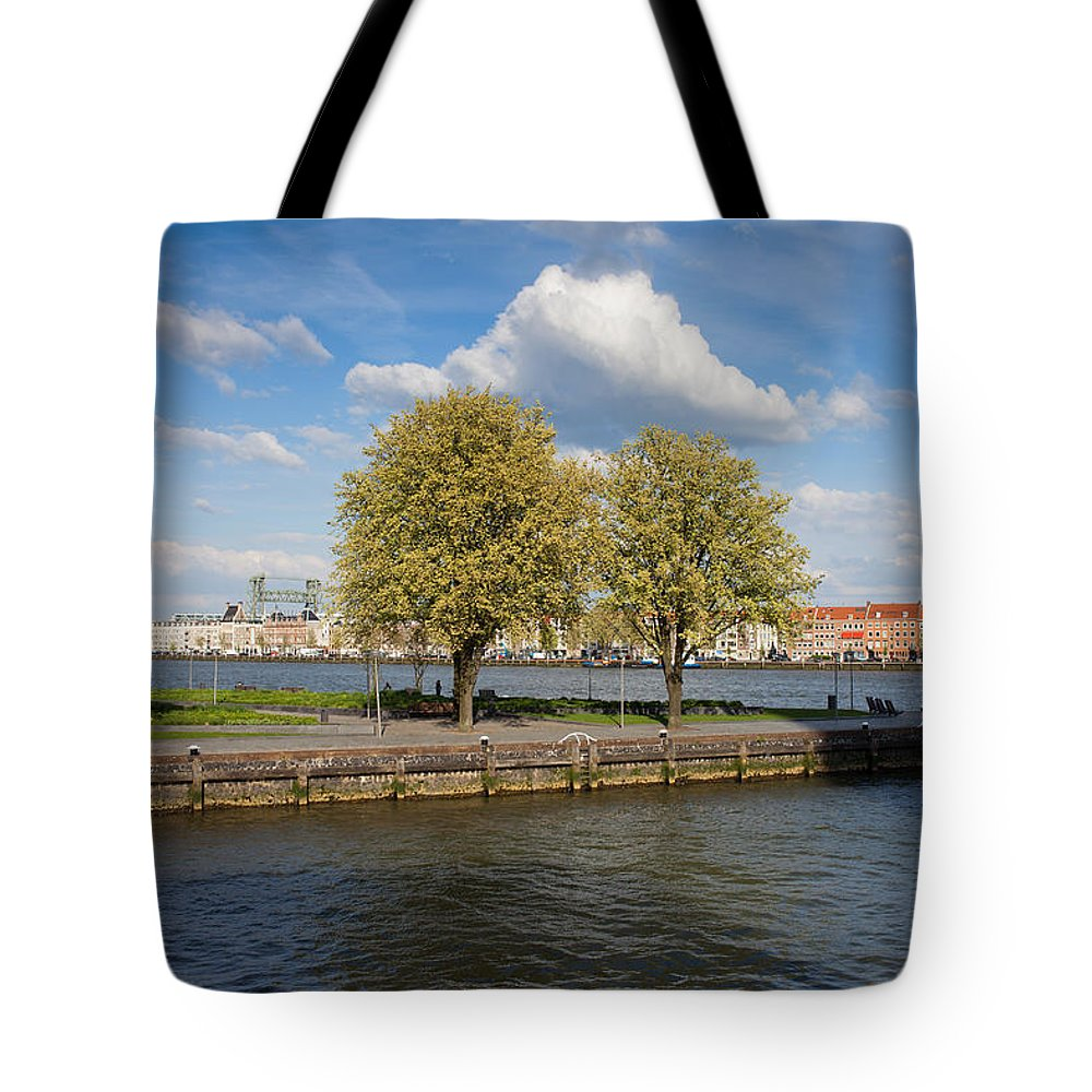 Rotterdam Tote Bag featuring the photograph Nieuwe Maas River Waterfront In Rotterdam by Artur Bogacki
