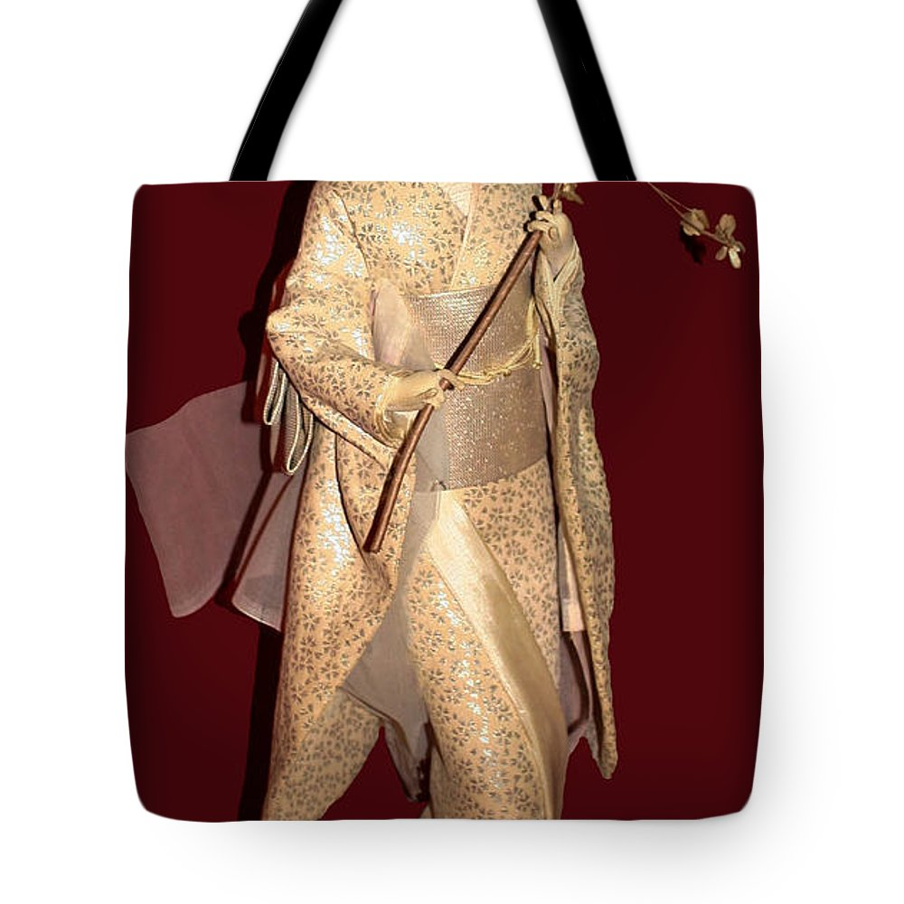 Nishi Doll Tote Bag featuring the photograph Nishi Doll by Mechala Matthews