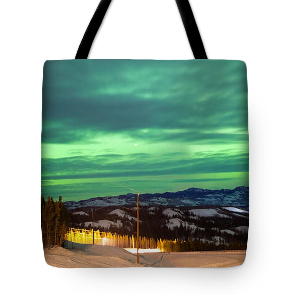Alaska Tote Bag featuring the photograph Northern Lights Aurora Borealis Over Rural Winter by Stephan Pietzko