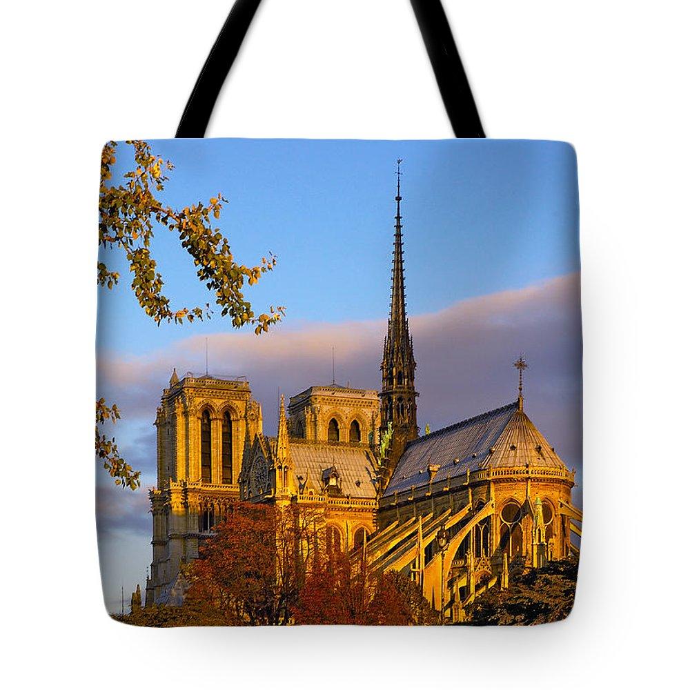 Paris Tote Bag featuring the photograph Notre Dame Sunrise by Mick Burkey