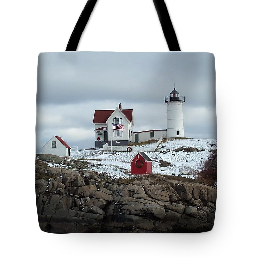 cape Neddick Maine Tote Bag featuring the photograph Nubble Light In December by Barbara McDevitt