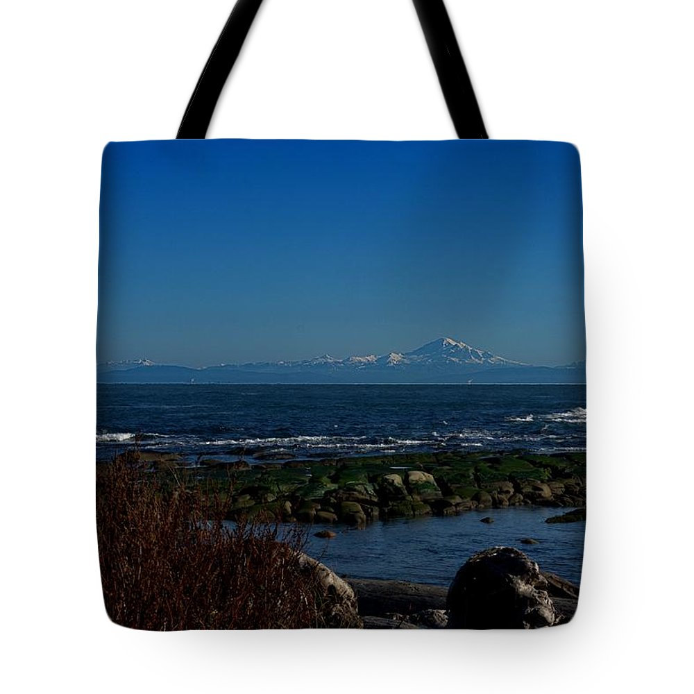 Ocean Tote Bag featuring the photograph Ocean And Mountains by John Greaves