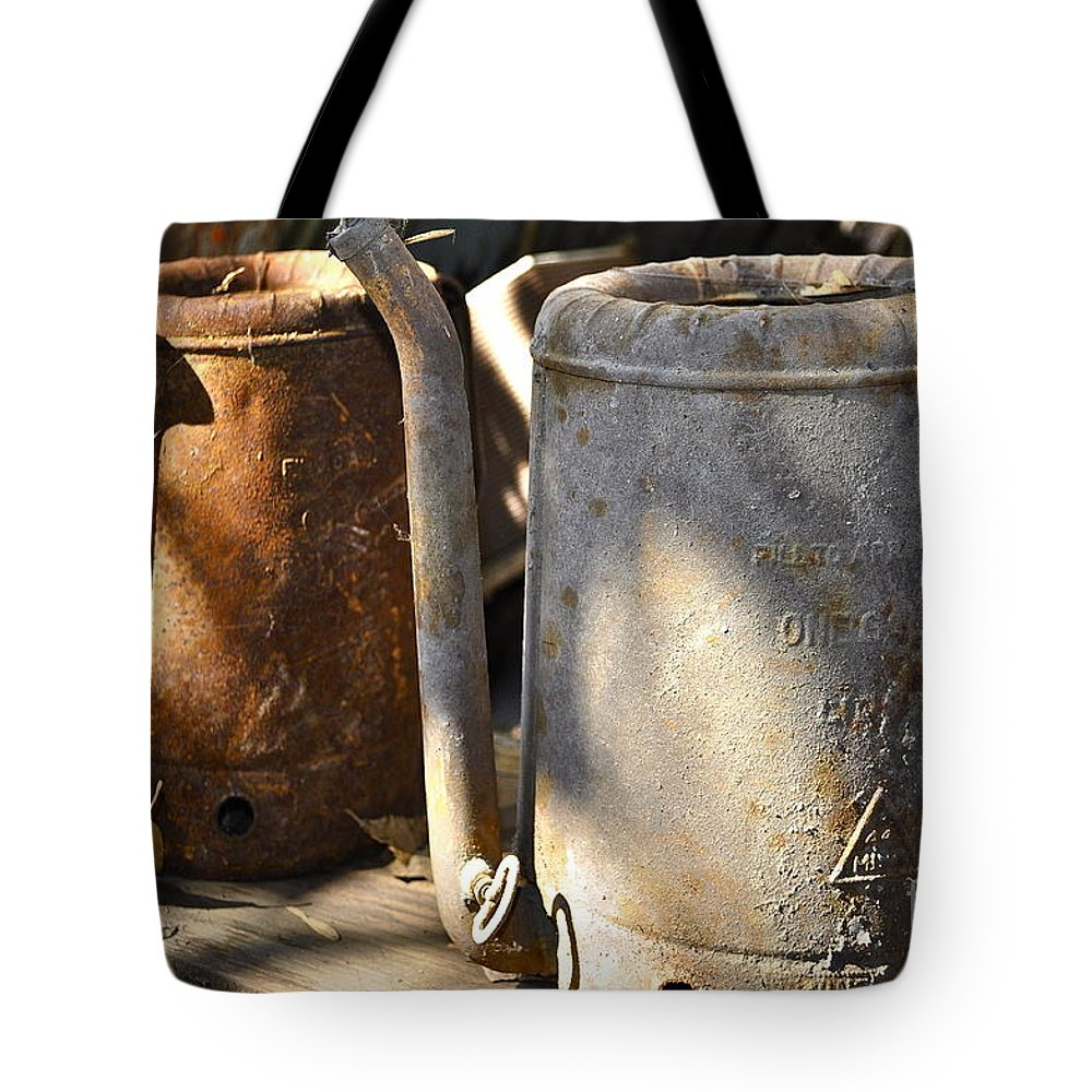 Oil Tote Bag featuring the photograph Oil Cans Picking by Gwyn Newcombe