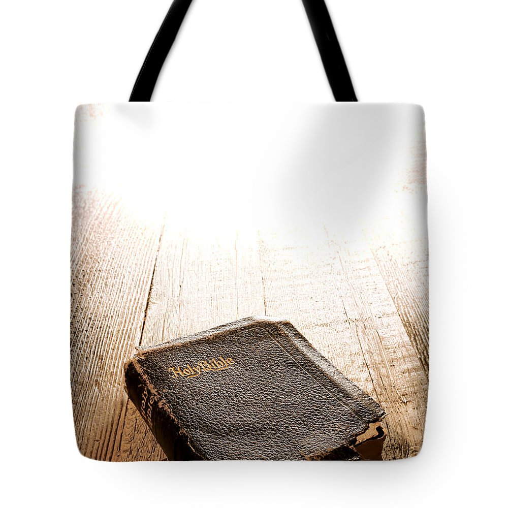 Holy Tote Bag featuring the photograph Old Bible In Divine Light by Olivier Le Queinec
