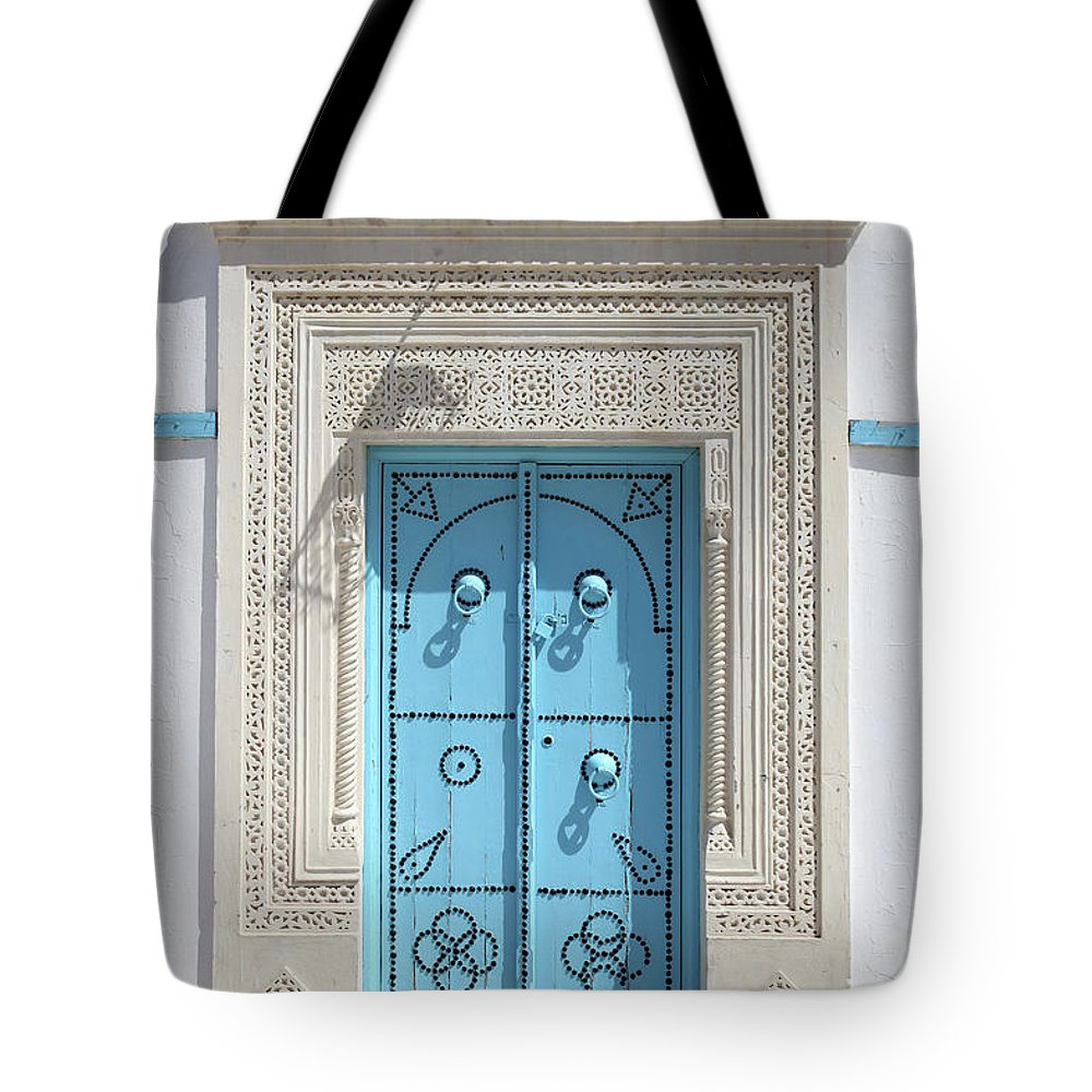 Molding A Shape Tote Bag featuring the photograph Old Blue Door by Iv-serg