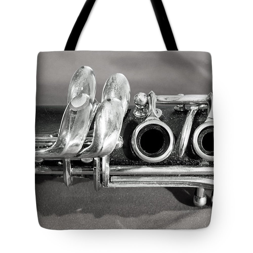 Old clarinet black and white tote bag for sale by photographic arts and design studio