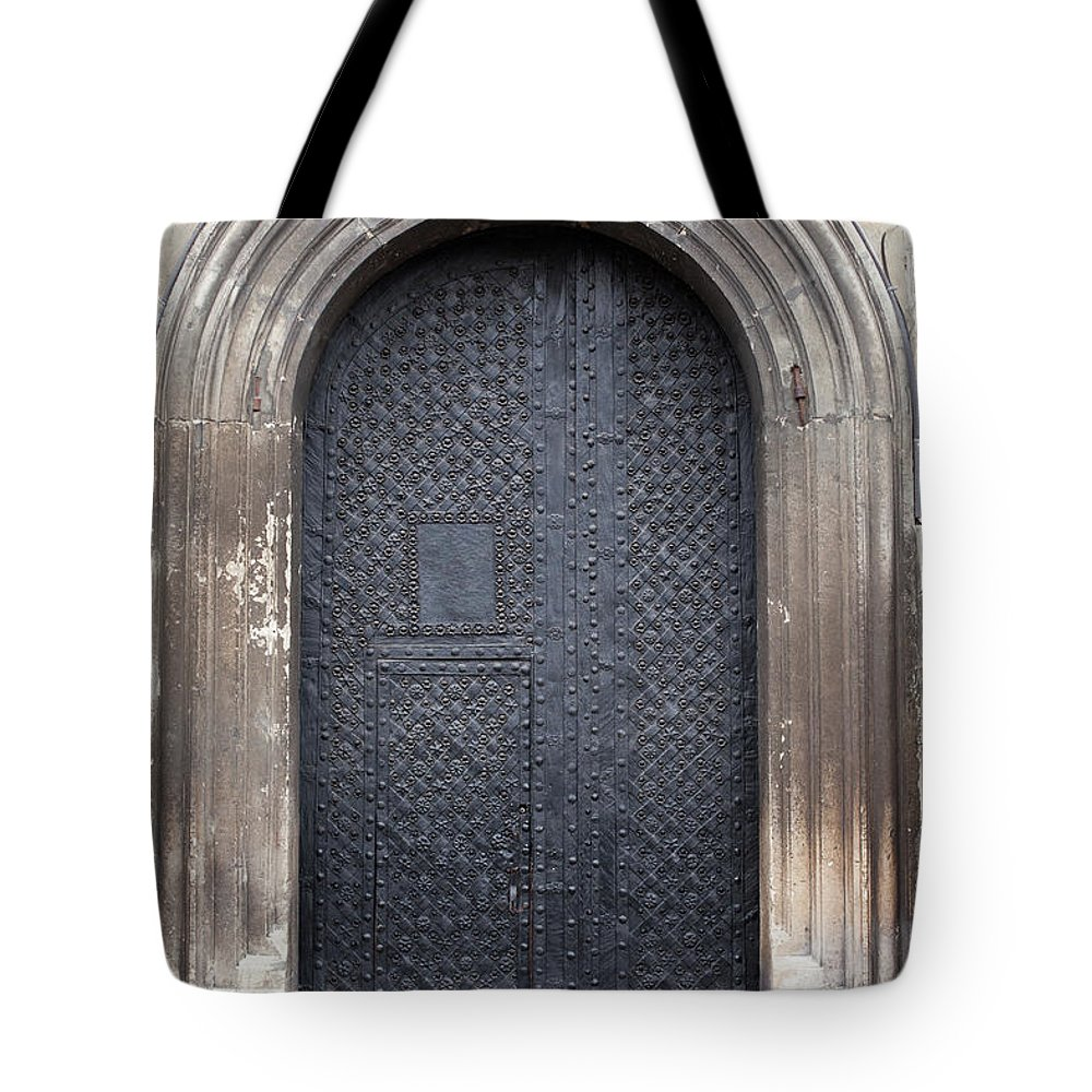 Gothic Style Tote Bag featuring the photograph Old Door by Viktor gladkov