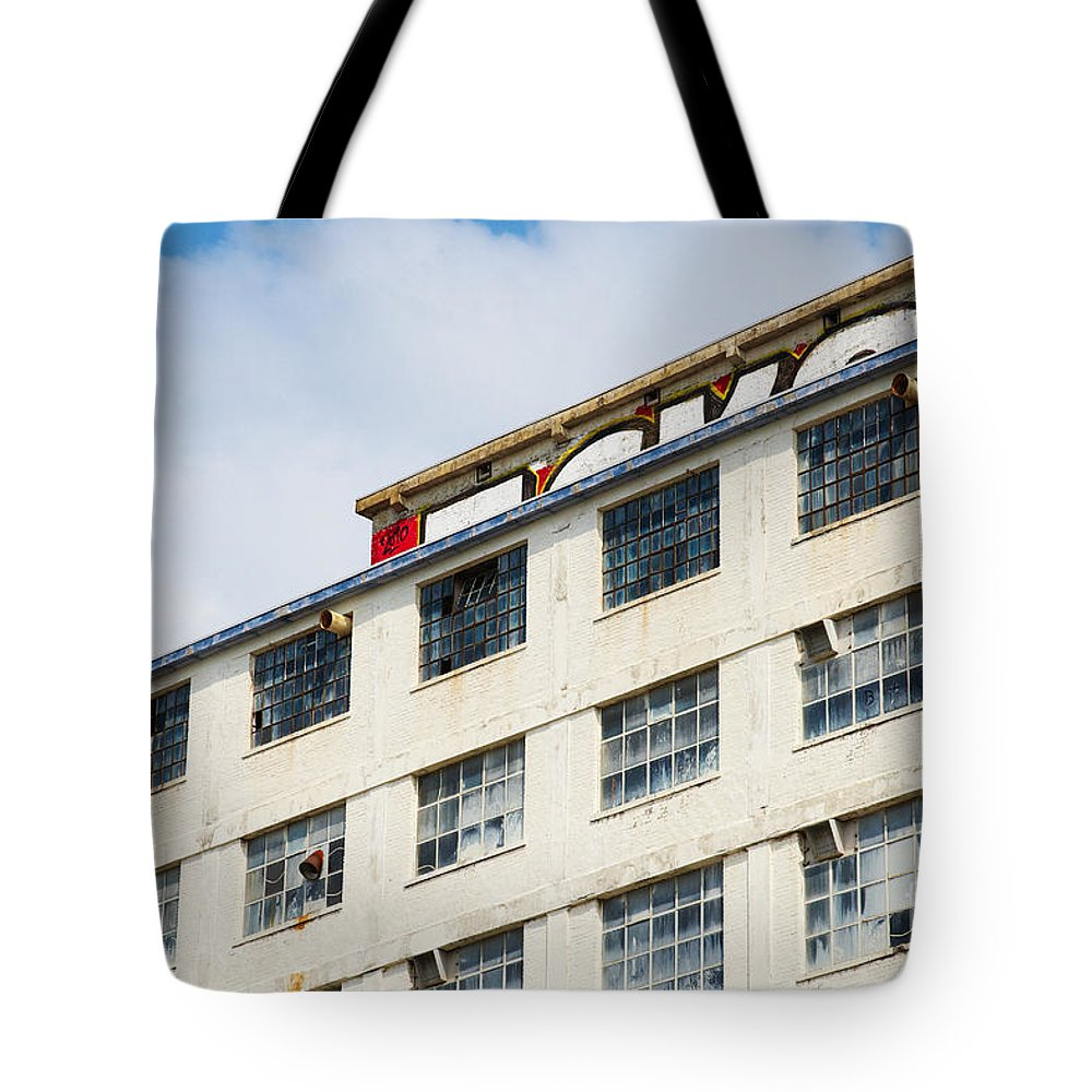 Old Tote Bag featuring the photograph Old Factory Under A Clear Blue Sky by Nick Biemans