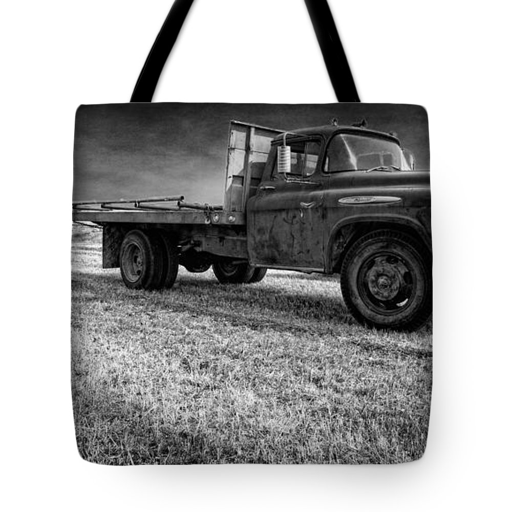 Truck tote bag featuring the photograph old farm truck black and white by edward fielding