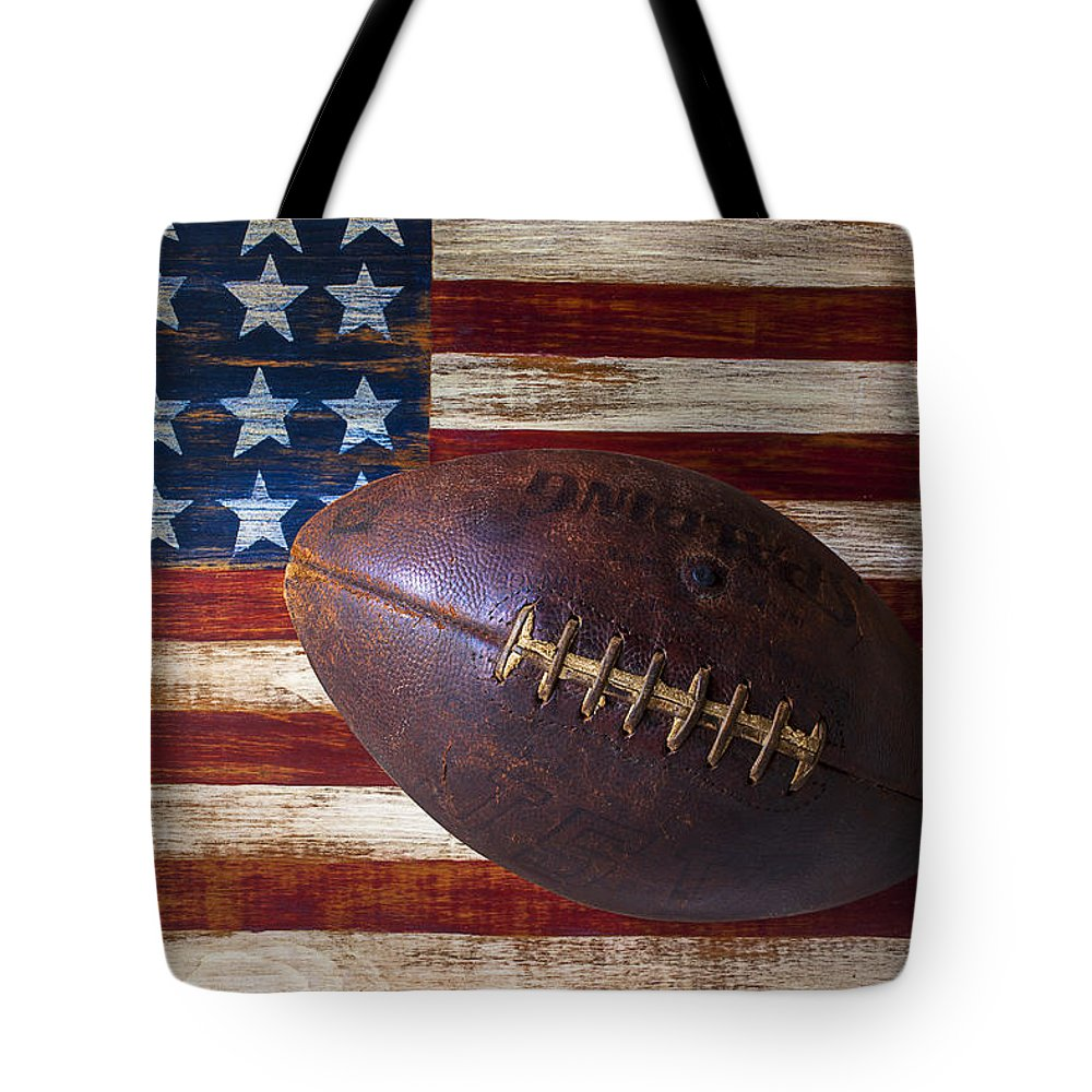 Football Tote Bag featuring the photograph Old Football On American Flag by Garry Gay