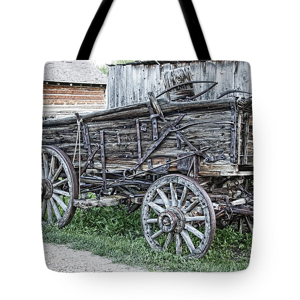 Wagon Tote Bag featuring the photograph Old Freight Wagon - Montana Territory by Daniel Hagerman