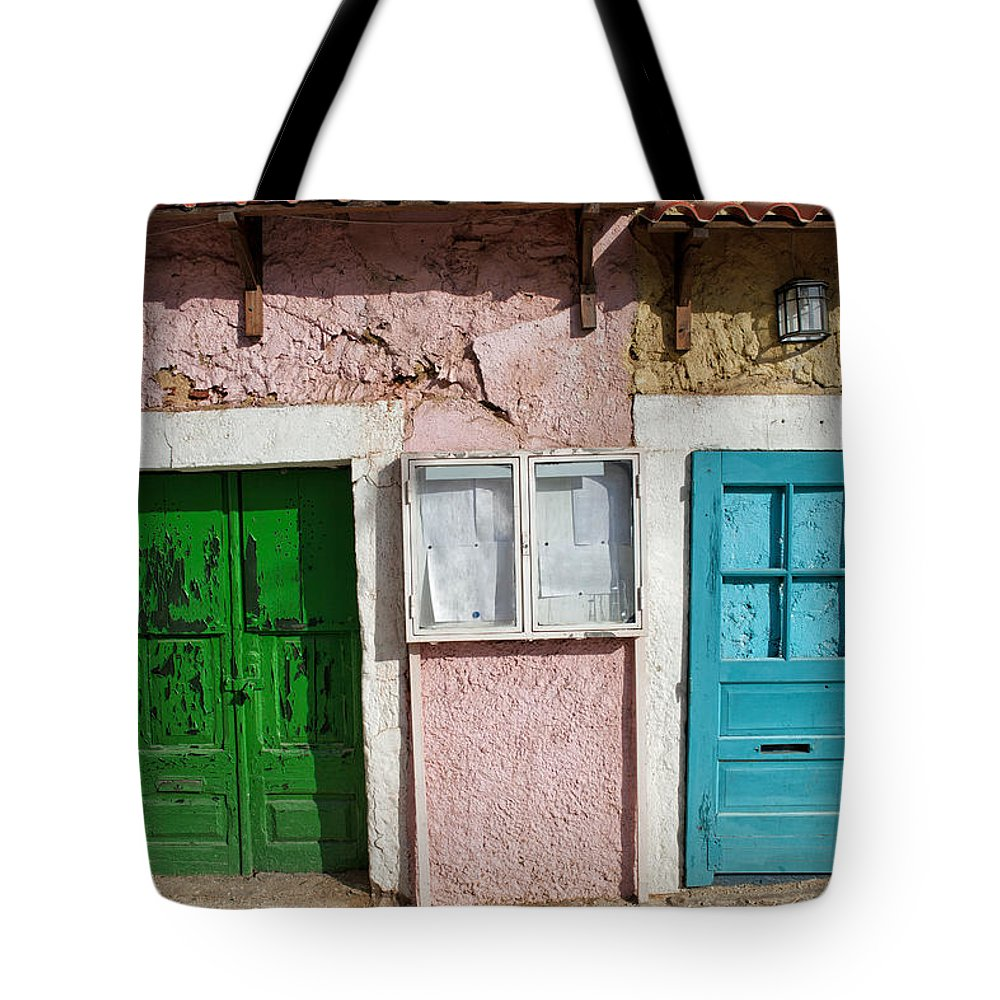 Apartment Tote Bag featuring the photograph Old House Doors In Lisbon by Artur Bogacki
