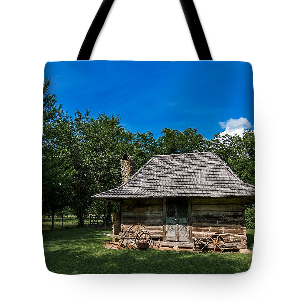 Bindery Tote Bag featuring the photograph Old Log Cabin Three by Ken Frischkorn