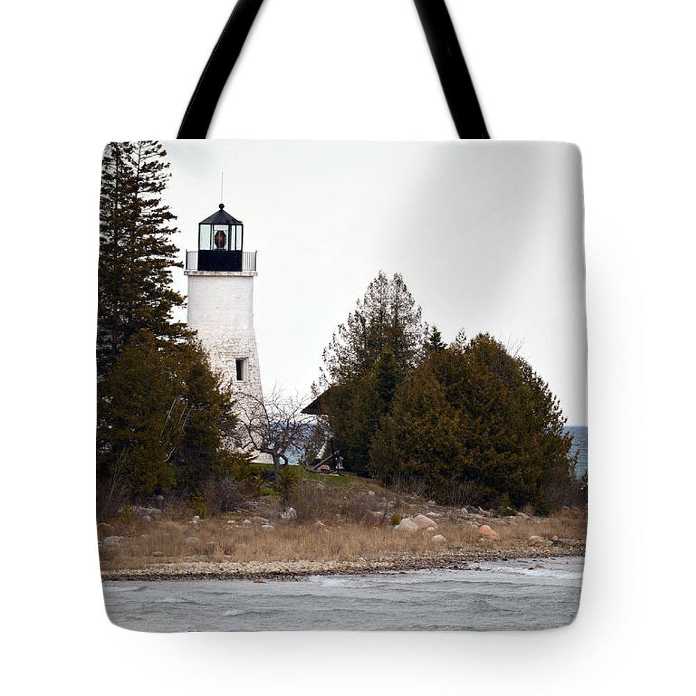 Presque Isle Tote Bag featuring the photograph Old Presque Isle Lighthouse by Linda Kerkau