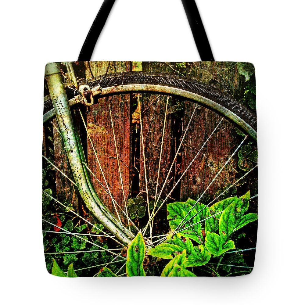 Bicycles Tote Bag featuring the photograph Old Spokes by John Anderson