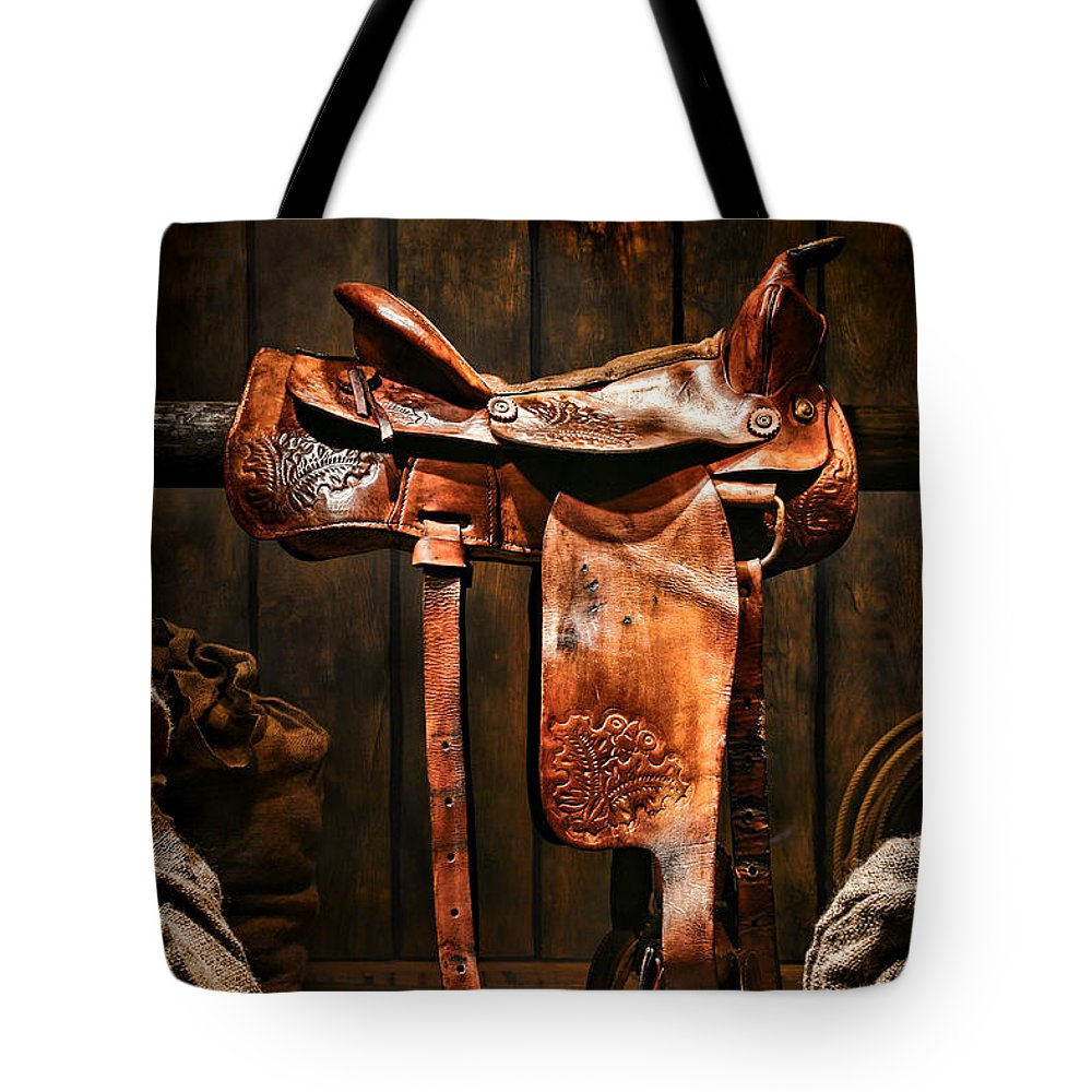 Saddle Tote Bag featuring the photograph Old Western Saddle by Olivier Le Queinec