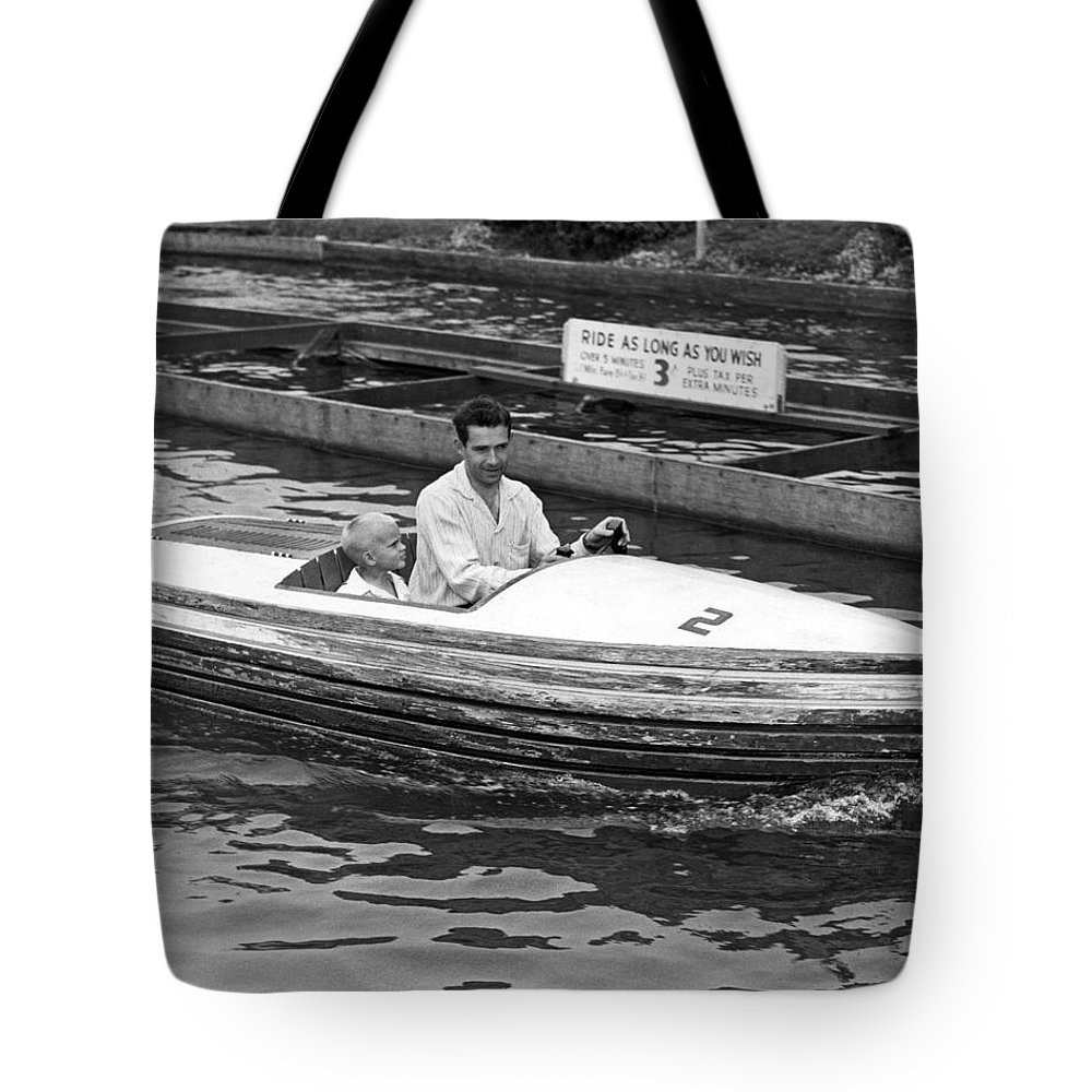 1950's Tote Bag featuring the photograph On A Boat Ride At Playland by Underwood Archives