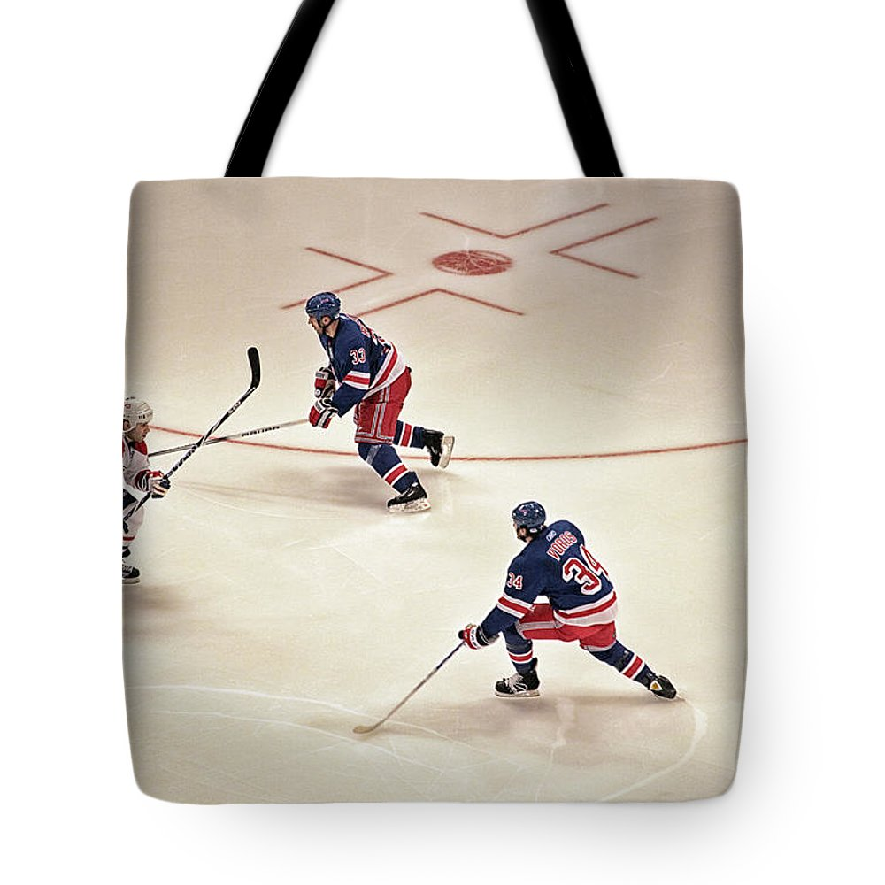 Hockey Tote Bag featuring the photograph On The Offense by Karol Livote