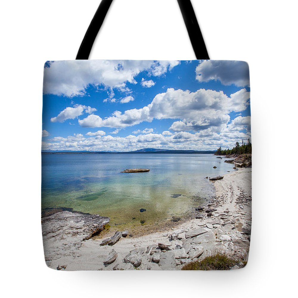 Yellowstone Lake Tote Bag featuring the photograph On The Shores Of Yellowstone Lake by Fran Riley