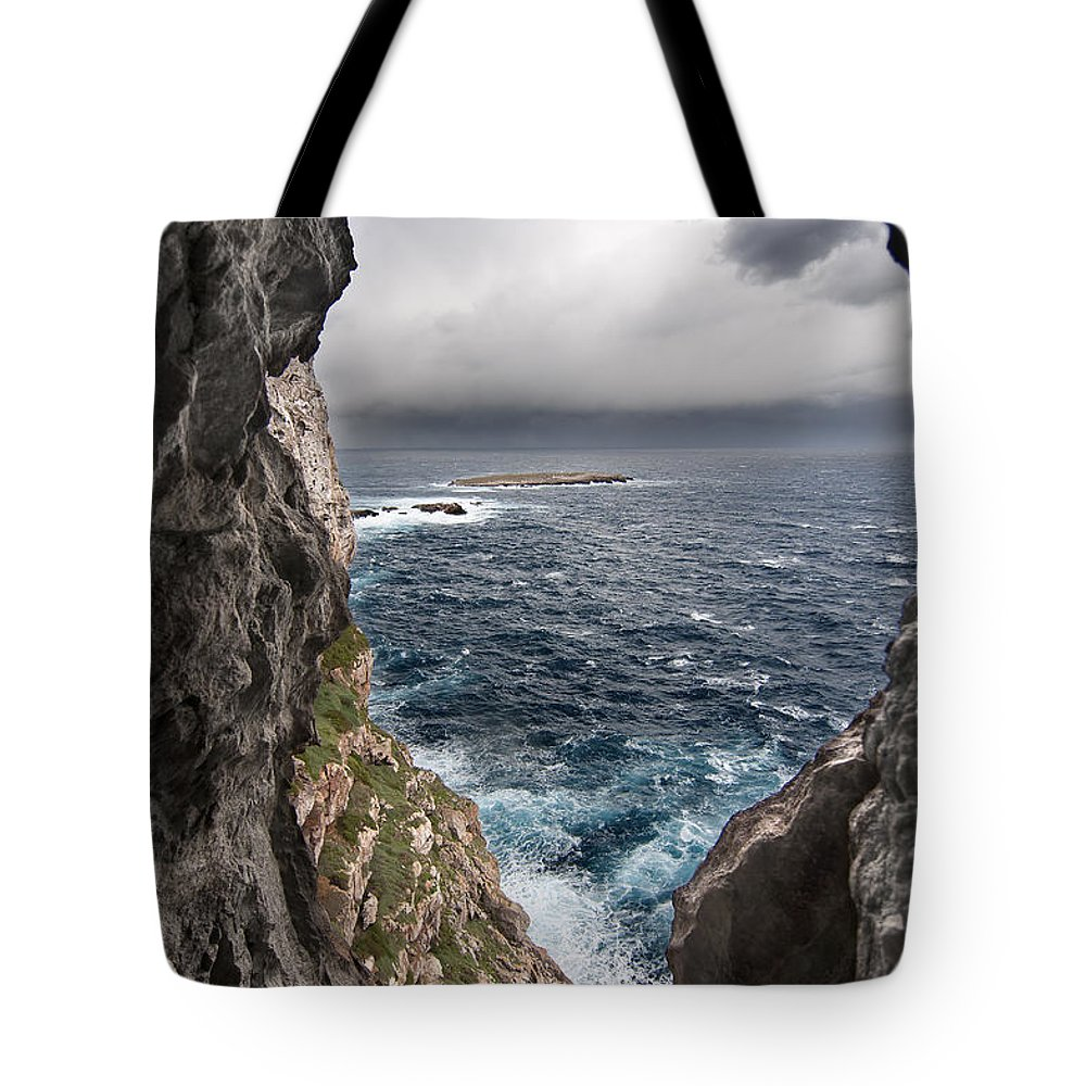 Background Tote Bag featuring the photograph A Natural Window In Minorca North Coast Discover Us An Impressive View Of Sea And Sky - Open Window by Pedro Cardona Llambias