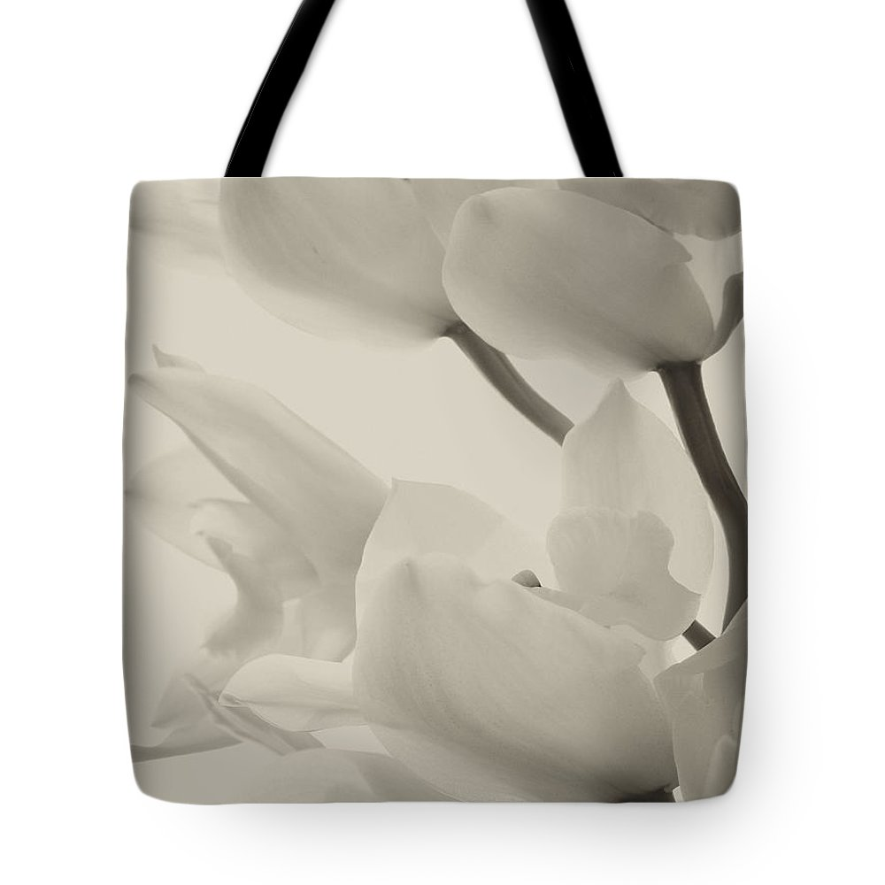 Flowers Tote Bag featuring the photograph Orchid Sepia by Joseph Hedaya