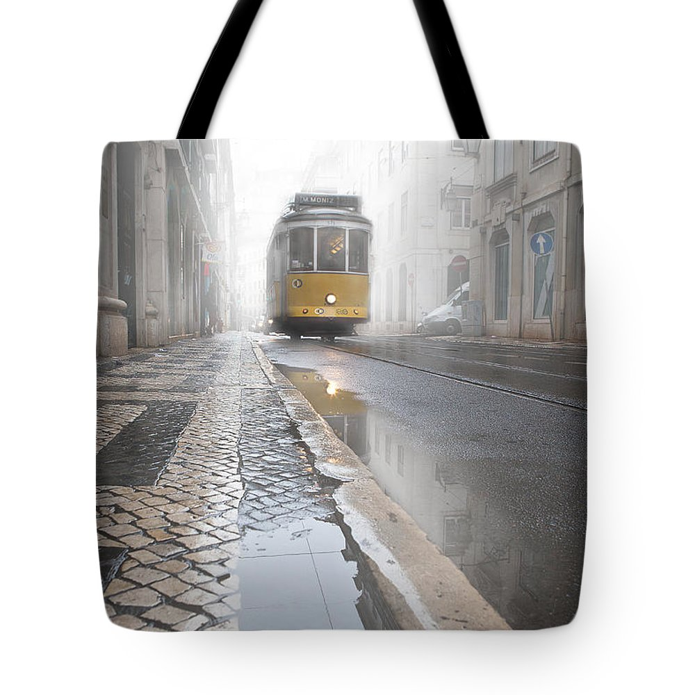 Lisbon Tote Bag featuring the photograph Out Of The Haze by Jorge Maia
