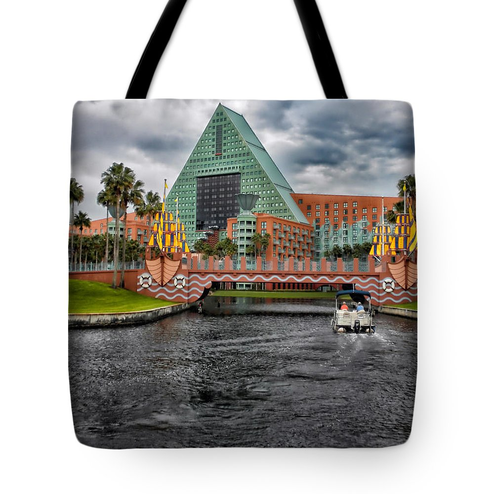 Magic Kingdom Tote Bag featuring the photograph Out Running The Storm At The Dolphin Resort by Thomas Woolworth