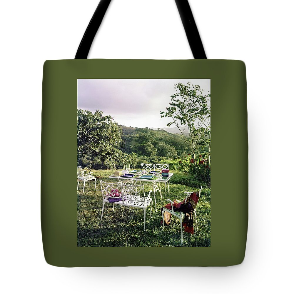 Outdoor Living Tote Bag featuring the photograph Outdoor Furniture By Lloyd On Grassy Hillside by Tom Leonard