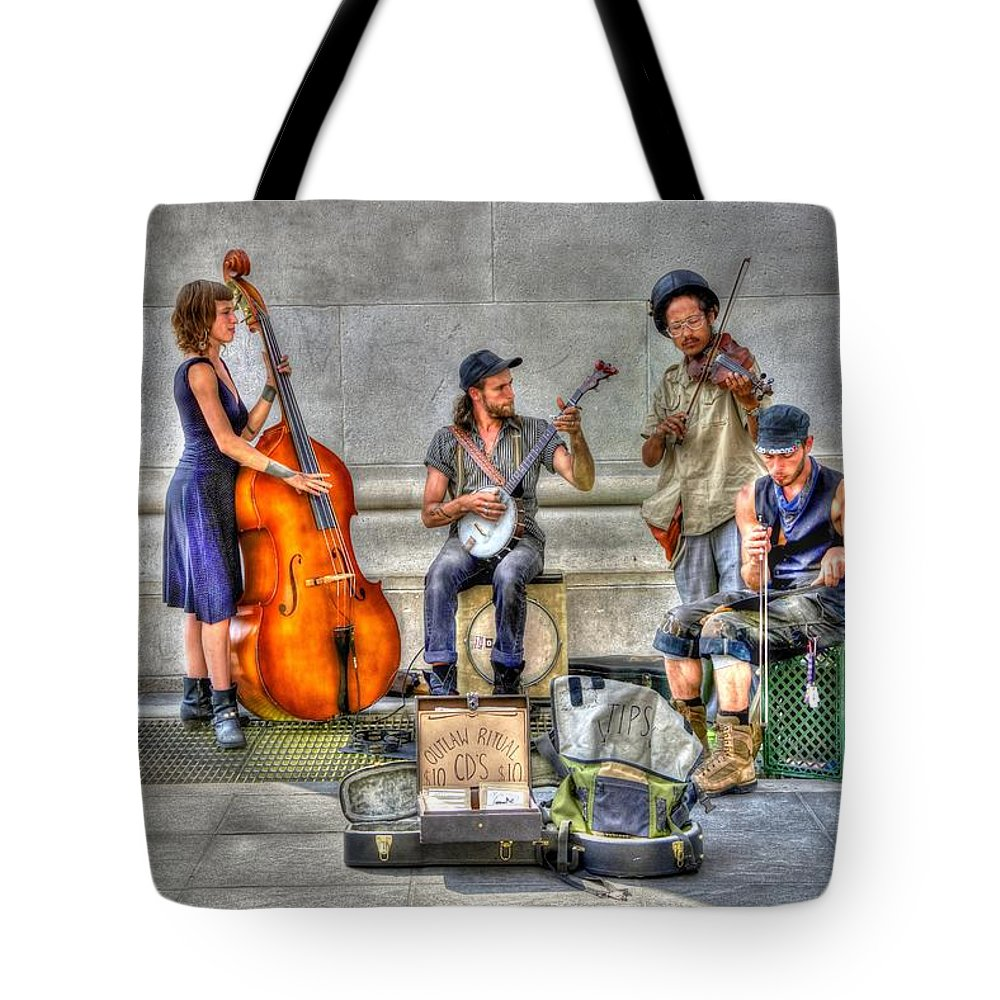 Outlaw Ritual Tote Bag featuring the photograph 'outlaw Ritual' Performing In Washington Square Park by Randy Aveille